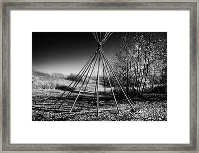 tipi wooden frame at Wanuskewin heritage park saskatoon Saskatchewan Canada Framed Print by Joe Fox