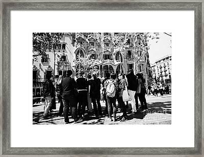 tourists tour group outside casa batllo modernisme style building in Barcelona Catalonia Spain Framed Print by Joe Fox