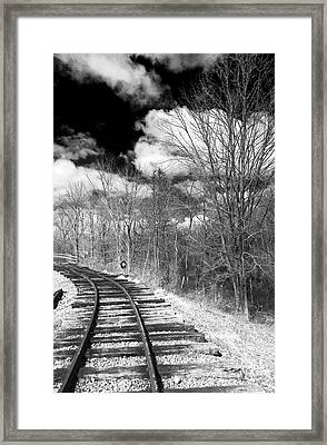 Tracks Framed Print by John Rizzuto