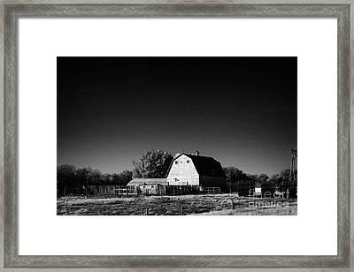 traditional Saskatchewan barn on farm in rural Canada Framed Print by Joe Fox