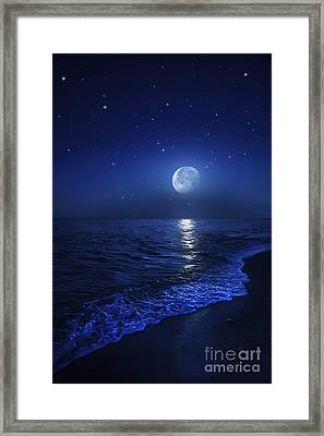 Tranquil Ocean At Night Against Starry Framed Print by Evgeny Kuklev