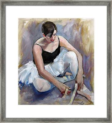 Tying Her Shoes Framed Print by Podi Lawrence