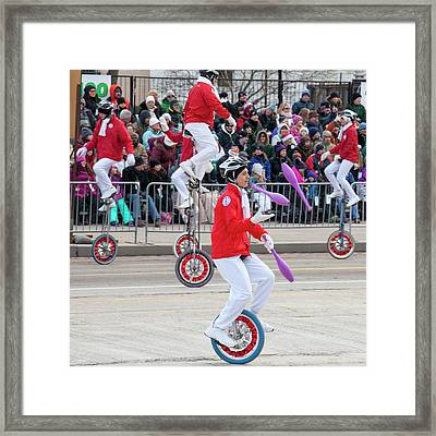 Unicyclists At A Parade Framed Print