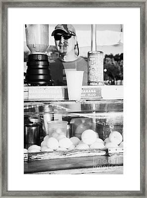 Vendor Selling Fresh Fruit Drinks Slushies At Mallory Square Key West Florida Usa Framed Print by Joe Fox
