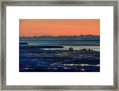 View Of The Anchorage Skyline At Sunset Framed Print by Michael Jones