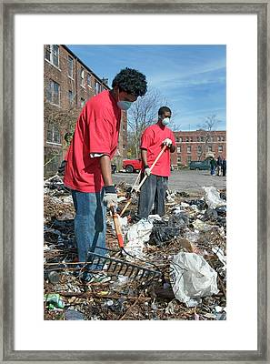 Volunteers Clearing Rubbish Framed Print by Jim West