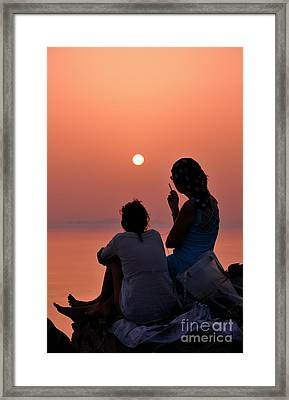 Watching The Famous Sunset In Oia Framed Print by George Atsametakis