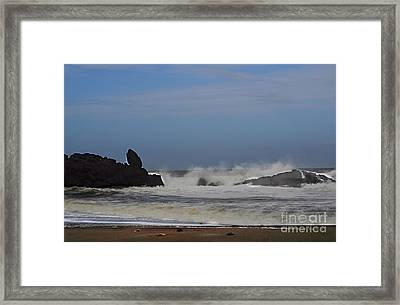 Waves Against The Rocks Framed Print by Mandy Judson
