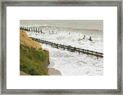 Waves Crashing Against The Sea Defences Framed Print by Ashley Cooper