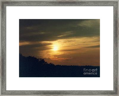 When The Clouds Roll In Framed Print
