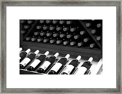 Wine Bottles On A Rack At A Winery Near The Vineyards Framed Print