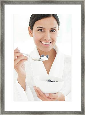 Woman Holding Bowl Of Fruit And Spoon Framed Print by Ian Hooton