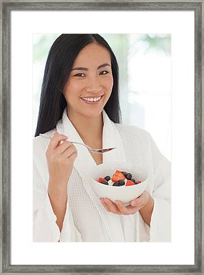 Woman Holding Bowl Of Fruit Framed Print by Ian Hooton