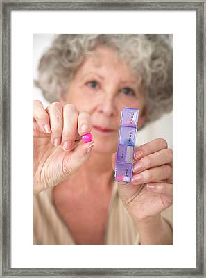 Woman Holding Pill And Pill Container Framed Print by Lea Paterson