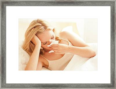 Woman In Bed Blowing Nose On Tissue Framed Print