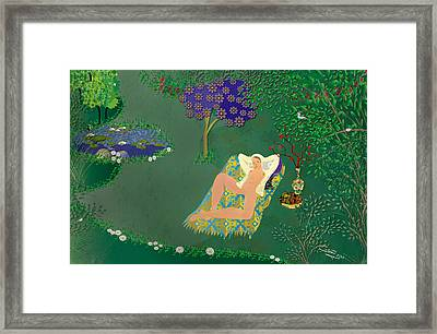 Woman In Garden With Pond Framed Print