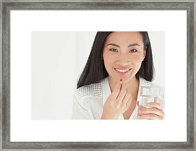 Woman Taking Tablet Framed Print