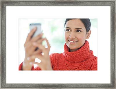 Woman Using Smartphone Framed Print by Ian Hooton