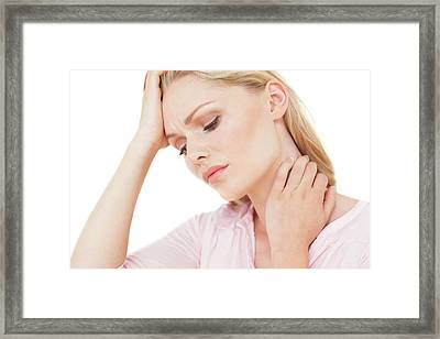 Woman With Hand On Neck Framed Print by Ian Hooton