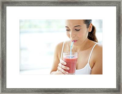 Woman With Smoothie Framed Print by Ian Hooton