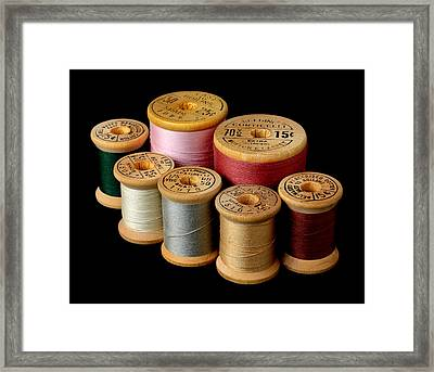 Wooden Spools Framed Print by Jim Hughes