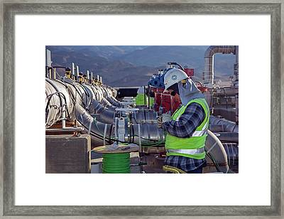 Worker Inspecting Water Pumps Framed Print by Jim West