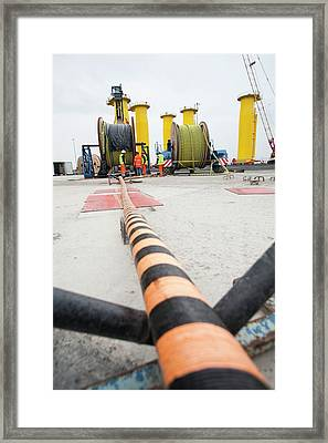 Workers Working On A Wind Turbine Framed Print by Ashley Cooper