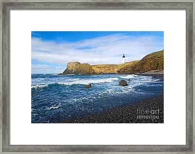 Yaquina Lighthouse On Top Of Rocky Beach Framed Print by Jamie Pham