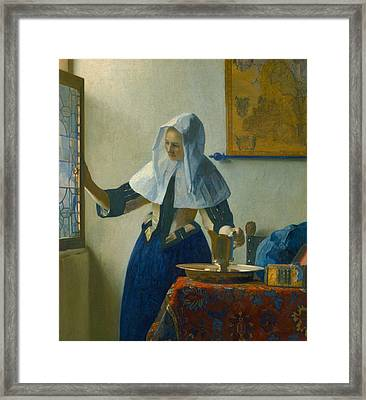 Young Woman With A Water Pitcher Framed Print by Johannes Vermeer