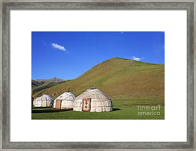 Yurts In The Tash Rabat Valley Of Kyrgyzstan  Framed Print by Robert Preston
