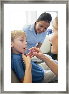 Administering Antibiotics Framed Print