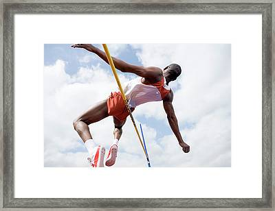 Athlete Performing A High Jump Framed Print by Gustoimages/science Photo Library