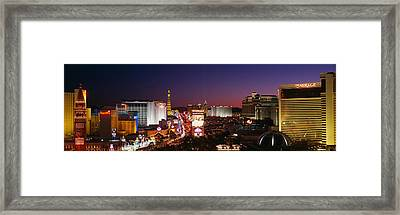 Buildings Lit Up At Night, Las Vegas Framed Print by Panoramic Images