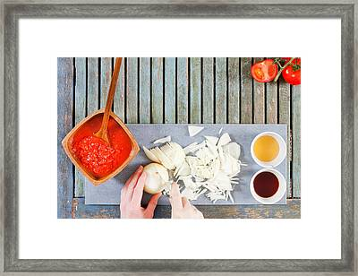 Chopping Onions Framed Print by Tom Gowanlock