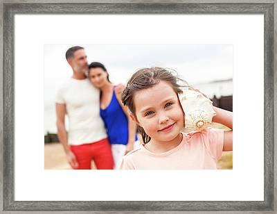 Girl With Seashell Framed Print