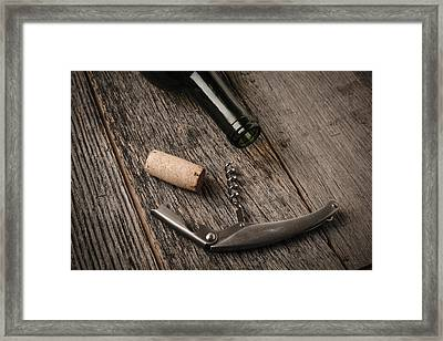 Green Wine Bottle And Cork With Red Wine And Corkscrew Framed Print by Brandon Bourdages