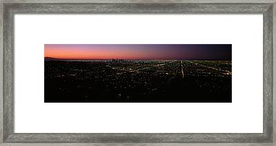 High Angle View Of A City At Night Framed Print