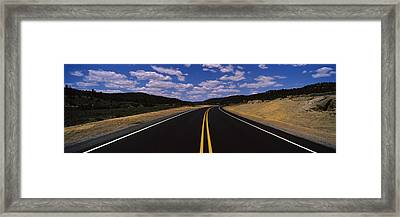 Highway Passing Through A Landscape Framed Print