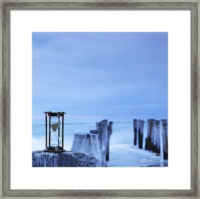 Hourglass Blue Sky Framed Print