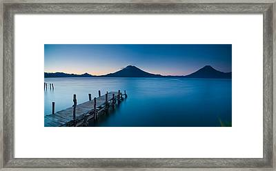 Jetty In A Lake With A Mountain Range Framed Print by Panoramic Images