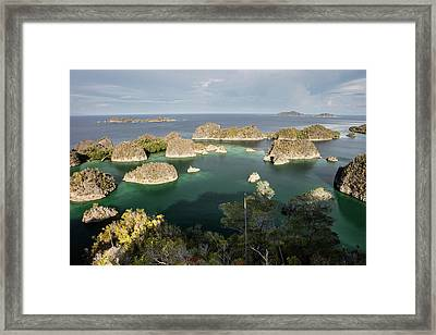 Limestone Islands Surround A Beautiful Framed Print