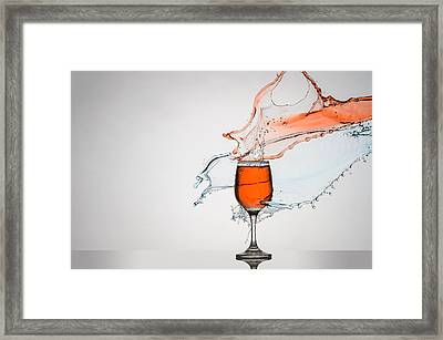 Liquid Splash Wine Glass Framed Print by Andy Astbury