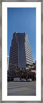 Low Angle View Of An Office Building Framed Print by Panoramic Images