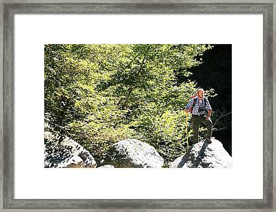 Man Hiking In The Sun Framed Print by Mauro Fermariello/science Photo Library