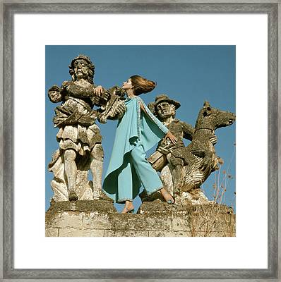 Model Standing Between Statues At The Villa Framed Print
