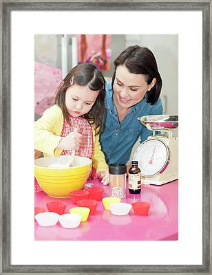 Mother And Daughter Baking Framed Print