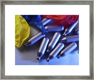 Nitrous Oxide Capsules Framed Print by Cordelia Molloy