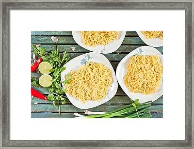 Noodles Framed Print by Tom Gowanlock