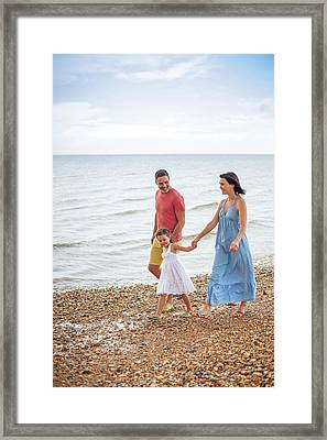 Parents On Beach With Daughter Framed Print by Ian Hooton