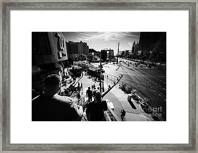people riding on escalators on Las Vegas boulevard Nevada USA Framed Print
